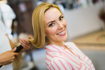 Happy young beautiful woman at the hair salon © nd3000