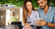 Leinwandbild Motiv Couple in love shopping online using tablet