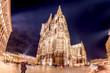 Leinwandbild Motiv Landmark in Germany, illuminated Cologne Cathedral at night