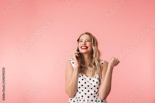Beautiful young blonde woman wearing dress standing © Drobot Dean