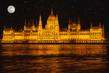 Panorama night Budapes.Capital of Hungary.Beautiful big old town.The photo is made in the dark.The magnificent city is rich in history.City landscape with a wide large river.Beautiful golden city. - 246417746