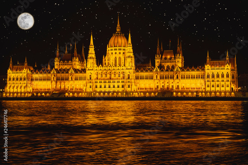 fototapeta na ścianę Panorama night Budapes.Capital of Hungary.Beautiful big old town.The photo is made in the dark.The magnificent city is rich in history.City landscape with a wide large river.Beautiful golden city.