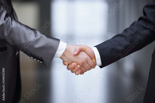 close up.handshake of business partners on the background of the office