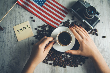 woman hand coffee with travel concept on table