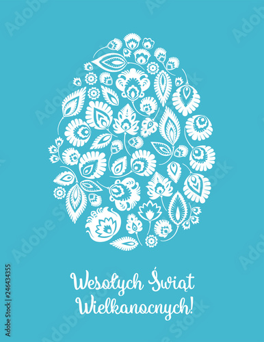 Wesołych Świąt Wielkanocnych – kartka wielkanocna z tradycyjną wycinanką łowicką na niebieskim tle © Ivonn