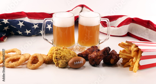 Foto Murales Chips, salty snacks, football and Beer on a table. Great for Bowl Game projects.