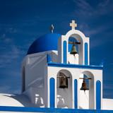 church in santorini greece with blue dome