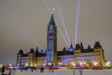 Scenic view of parliament of Canada building on bank of Ottawa river in Ontario in capital of country. Depressive beautiful winter look of old historic famous government building in night illumination - 246453144