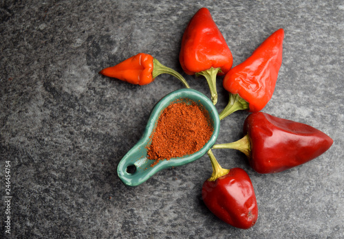 Raw ripe fresh red pepper with powder spice - 246454754