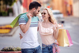 Attractive couple with shopping bags - 246456591