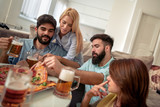 Group of happy young people eating pizza - 246456736