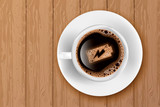 Cup of coffee with battery energy on foam. Realistic vector illustration