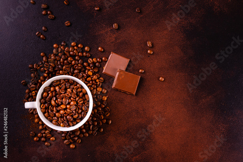 Seeds of fragrant coffee, coffee drink on a dark concrete background. It can be used as a background © chernikovatv