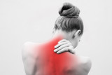 Young woman having pain in the back and neck. Health-care Concept. - 246483932