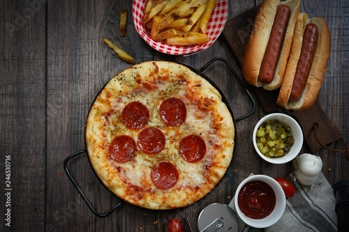 Leinwanddruck Bild Party game day food Homemade Pizza hot dogs fries and dips ,top view