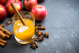Old fashioned apple beverage on the rustic background. Selective focus. - 246520999