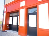 orange shop on the street with blank billboard banner space for text advertising - 246547789
