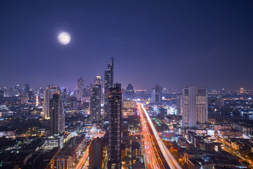 scenic of night cityscape with full moon on twilight skyline © bank215