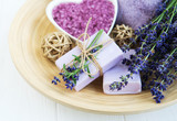 Heart-shaped bowl with sea salt, soap and fresh lavender flowers
