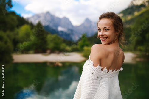 Leinwanddruck Bild Young happy woman on the lake