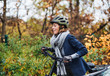 Leinwanddruck Bild - Active senior woman with electrobike cycling outdoors in park.