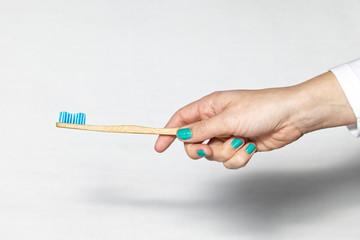 Bamboo Toothbrush isolated on white © KOKALA VIEW