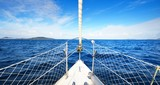 View from the bow of a yacht with a view of calm blue sea
