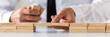 Leinwandbild Motiv Wide view image of businessman making a bridge of wooden pegs