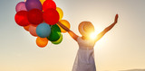 happy woman with balloons at sunset in summer - 246631501