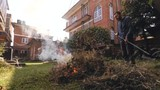 Time-lapse of man burning green waste in his garden - 246649125