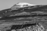 black and white snow capped hill in the Yorkshire dales.