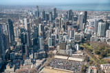 MELBOURNE - SEPTEMBER 8, 2018: Aerial view of city skyline and car parking from helicopter. Melbourne attracts 15 million people annually - 246655987