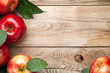 Red Apples with Green Leaves on Wooden Table - 246667513