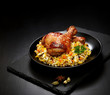 grilled chicken legs with sesame and rice on a black background - 246676739