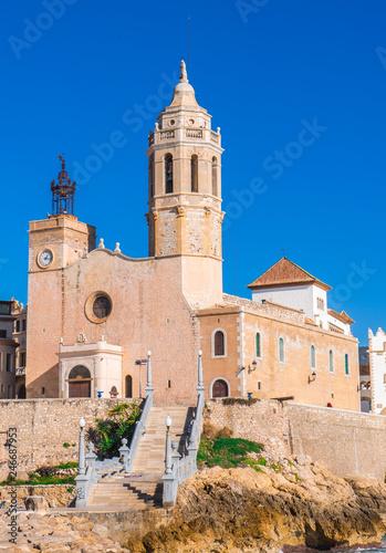 fototapeta na ścianę Sitges church with a blue sky Sant Bartomeu & Santa Tecla in Barcelona, Spain