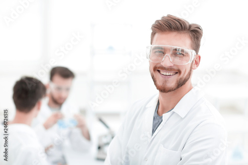 Leinwanddruck Bild closeup.successful scientist on a light background