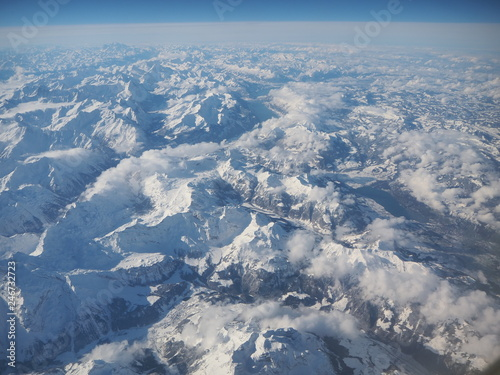 Aerial landscape of the Alps in Europe during winter season with fresh snow. View from the window of the airplane - 246732723