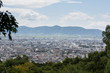 Kyoto city in Kyoto, Japan. The view from Kiyomizu-dera temple make it looks like a hidden city in a mysterious place that surrounded by mountains and trees.   - 246766905