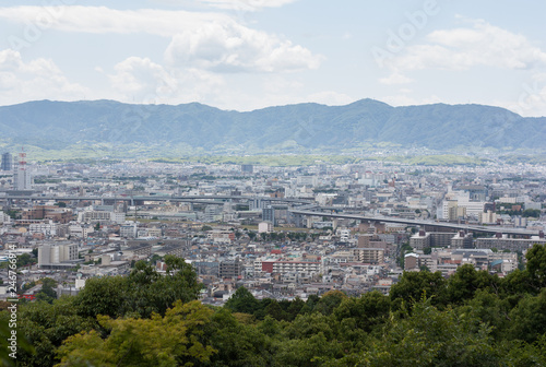 Kyoto city in Kyoto, Japan. The view from Kiyomizu-dera temple make it looks like a hidden city in a mysterious place that surrounded by mountains and trees.   - 246766914