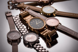 selective focus of luxury wristwatches on grey background