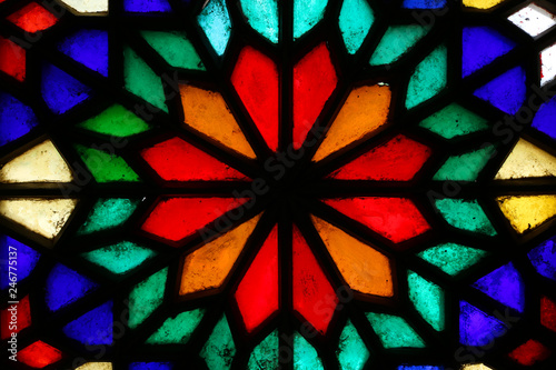 Beautiful colorful stained glass window in Yazd, Iran © Skaniai