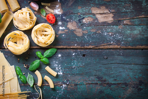 Leinwanddruck Bild Italian food background with different types of pasta, health or vegetarian concept. Top view with copy space.