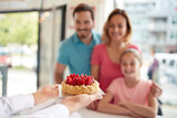 Strawberries cake for girl with parents in confectionery - 246784736