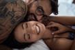 Leinwanddruck Bild - Smiling Man passionately kissing with a beautiful girl.