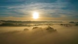 Fog mistery reveal drone shot at sunrise - 246807363