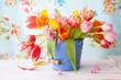 Leinwanddruck Bild - Bunte Tulpen in kleinem Eimer