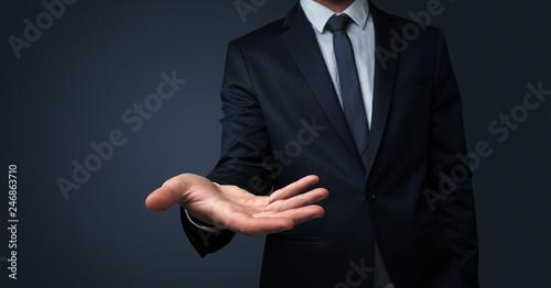 Leinwandbild Motiv Businessman without head holding something without theme