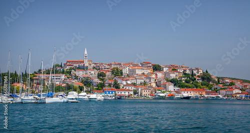 Leinwandbild Motiv View from the sea on the old historic town of Porec, Croatia.