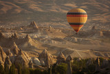 Beautiful landscape of Cappadocia valley with hot air balloons in background at sunrise - 246895363