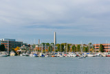 Bunker Hill Monument over boats by Charles River in Charlestown, Boston, USA